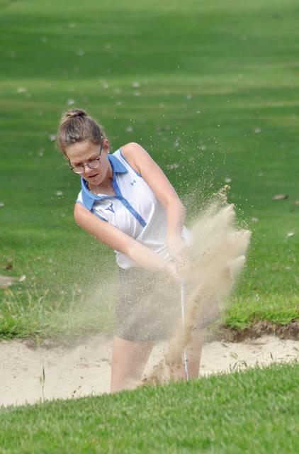 Rob Kiser/Call Photo Miami East's Annelise Logan blasts out of a bunker on the first hole.