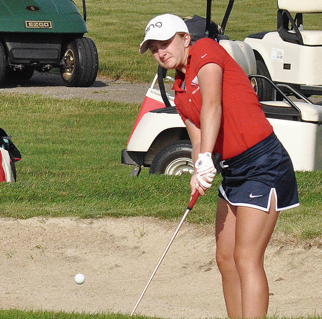 Rob Kiser/Call Photo Piqua's Kelsey Bachman hits out of a bunker on the sixth hole Thursday at Echo Hills.