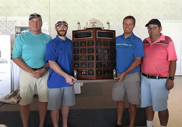 Rob Kiser/Call Photo The net winners of the Dick Minnich Charity Classic golf scramble were (left to right) Doug Foster, Caleb Lavey, Michael Meredith and Rob Kiser.