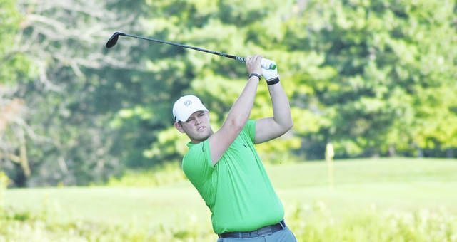 Rob Kiser/Call Photo Paul VanDeventer watches his tee shot on the fifth hole Sunday at Piqua Country Club.