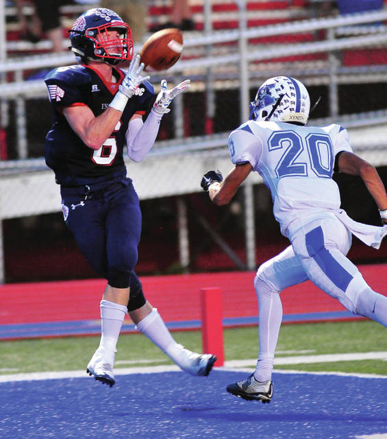 Mike Ullery/Call Photo Piqua's Hayden Schrubb hauls in one of this three TD passes Friday night.