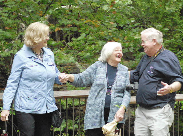 Anthony Weber | Troy Daily News Siblings Maryann Owen, left, Barbara Huston, center and Tom Owen share a laugh while walking around the area of the creek and falls at Charleston Falls recently near Tipp City.
