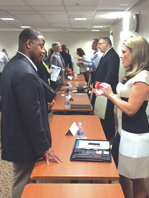 Provided photo Representatives of women- and minority-owned businesses speak with Premier Health officials during a June 2016 supplier diversity community outreach event at Miami Valley Hospital, Dayton.