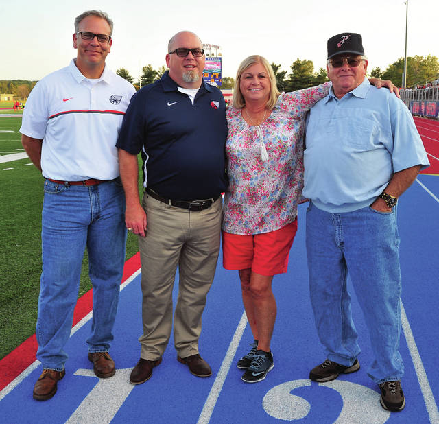 Mike Ullery | Daily Call Four administrators have been principal at Piqua High School since it moved from Piqua Central in the early-1980s. All four were at Alexander Stadium/Purk Field on Friday for a ceremony honoring coach Bill Nees for 25 years at the helm of the Indians football team. From the left, Rob Messick, current PHS principal, Tony Lyons, Kathy Davisson, and Glenn Honeycutt