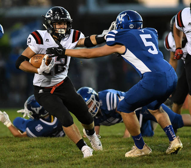 Ben Robinson/GoBuccs.com Covington's Ethan Herron finds running room Friday night.