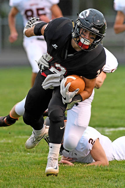 Ben Robinson/GoBuccs.com Ethan Herron breaks a tackle against Minster Friday night.