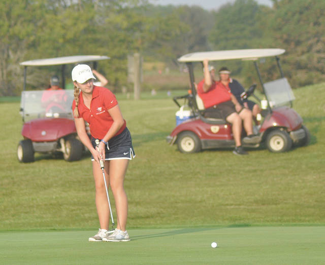 Rob Kiser/Call Photo Piqua's Kelsey Bachman watches a putt on the 18th green Wednesday at Beechwood Golf Course.