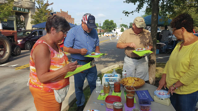Provided photo Judges for the salsa contest were, left to right, Julie Roeth, Craig Hughes and Bill Walters. Marsha Koon, a Farmers Market volunteer, assisted with the contest.