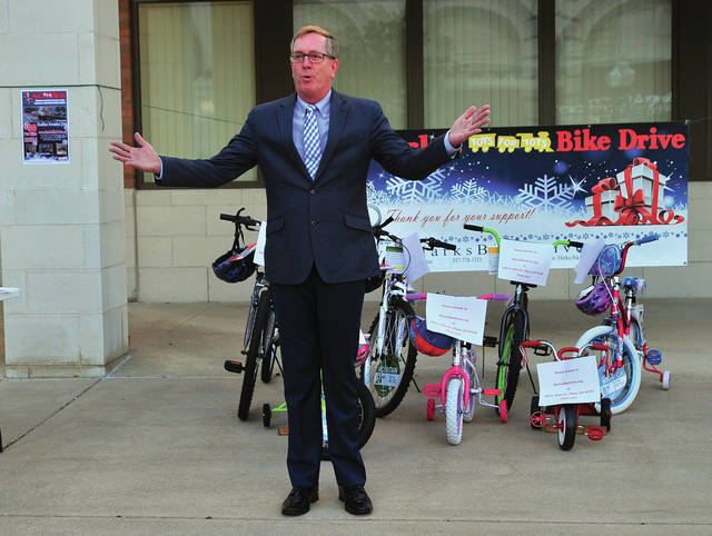 Mike Ullery | Daily Call  Mark Reedy of Thrivant Financial in Piqua announces his 2017 Bicycle Drive Campaign at the Piqua Municipal Complex on Tuesday morning.
