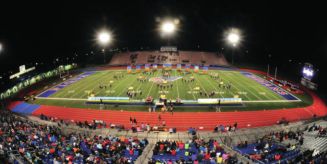 Mike Ullery | Daily Call The Pride of Piqua Marching Band takes the field at Alexander Stadium/Purk Field on Saturday during the annual Piqua Band Invitational.
