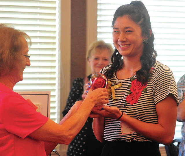 Mike Ullery | Daily Call The Miami County YWCA Young Woman of Tomorrow Award for 2017 was presented to Piqua High School graduate Ashley Ho during the annual Women of Excellence luncheon at the Piqua Country Club on Thursday. The Woman of the Year award went to Ruth Jenkins of Troy.