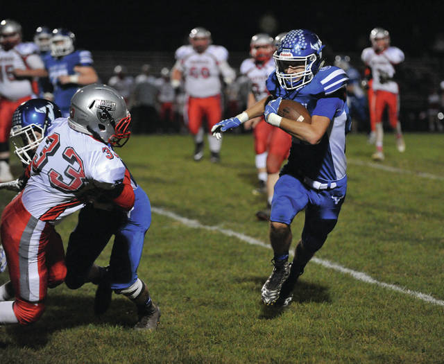Josh Brown/Troy Daily News Miami East's Justin Brown follows his downfield blockers on a 30-yard touchdown run Friday night against Tri-County North.