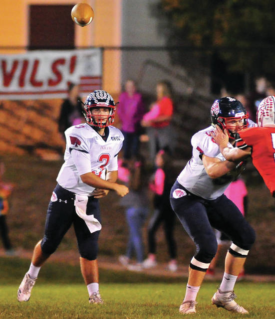 Mike Ullery/Daily Call Senior quaterback Austin Davis, 3, finds a target.