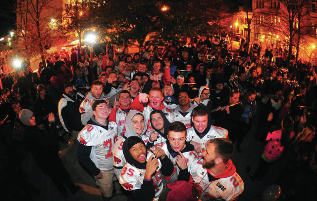 Mike Ullery | Daily Call Piqua's senior football players get ready to take the stage as the Piqua High School band fires up a large crowd in downtown Piqua on Wednesday as the Indians get set to take the field on Friday night to renew Ohio's oldest high school football rivalry against the Troy Trojans.