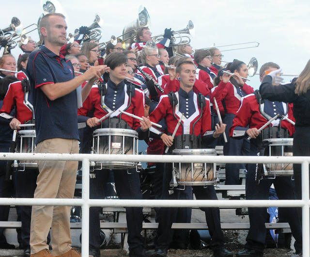 The Piqua High School Marching Band fires up the crowd before the game.