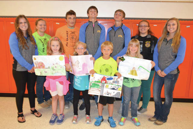 Provided photo FFA Members presented prizes to the winners of the Farm Safety Poster Contest (back row, left to right) Rachael Hodge, Kylie Blair, Alex DiNardo, Alex Isbrandt, Dylan Hahn, Emily Thimmes, Emma Younce. The winners were (front row, left to right) Bekah Taylor, Julia Gudorf, Austin Howell, and Kenzie Rich.