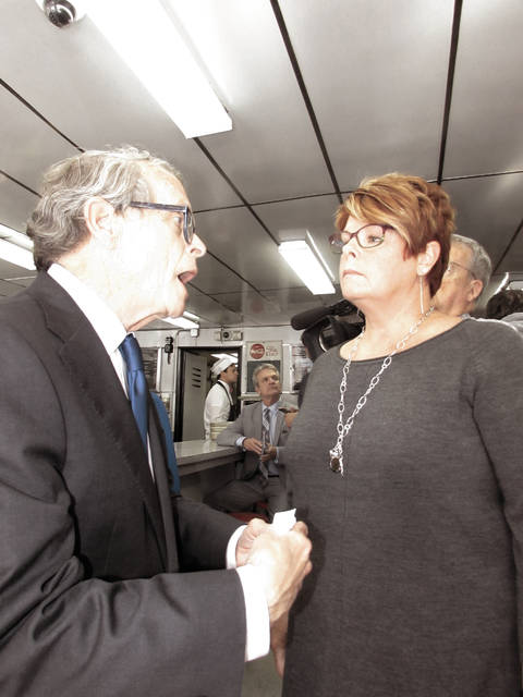 Attorney General and Republican candidate for Ohio governor Mike DeWine meets with Bonita Ritchie, associate pastor of Tipp City United Methodist Church at K's Hamburgers on Thursday. DeWine was endorsed by former Sen. Rick Santorum. Santorum stopped at the restaurant during the 2012 presidential campaign.