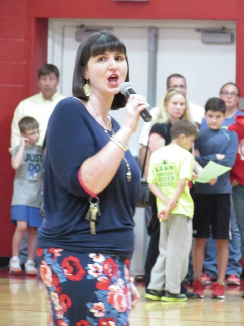 Sam Wildow | Daily Call Literacy Committee Chair and sixth grade teacher Leslie Mitchell introduces Piqua Central Intermediate School's first Literacy Night on Tuesday evening.
