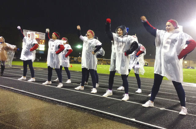 Cody Willoughby | AIM Media Midwest Piqua High School cheerleaders brave the cold, wet weather Friday night to cheer on their Piqua Indians against the Troy Trojans at Troy Memorial Stadium. For more on the game, see Page 10.