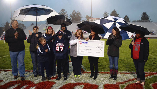 Provided photo Piqua High School Principal Rob Messick, blood drive coordinator April Watson and US Bank Piqua Manager Emily Shawler, along with other community members, accept the CBC/US Bank Troy-Piqua Challenge Blood Drive $1,000 award from US Bank Troy Manager Deborah Wildermuth.
