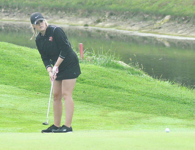 Rob Kiser/Call File Photo Versailles' Anna Groff watches a putt at the district tournament earlier this season.