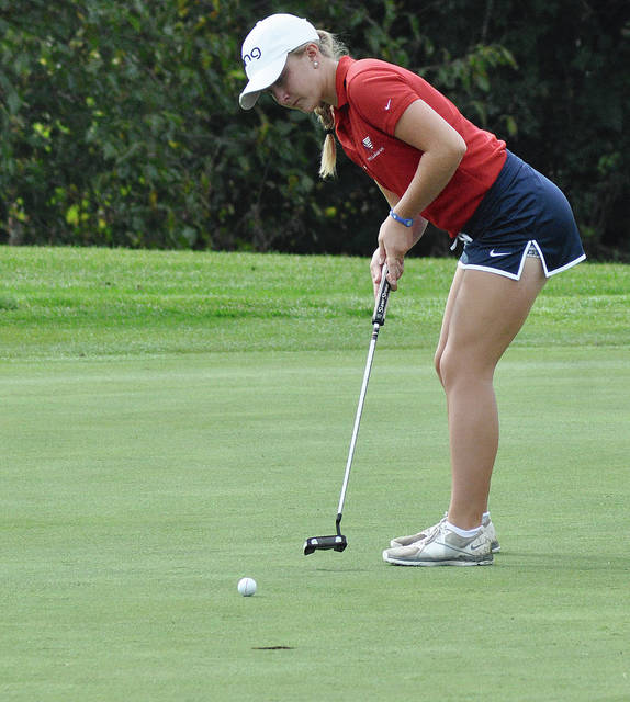 Rob Kiser/Call Photo Piqua's Kelsey Bachman hits a putt on the 10th green at Beavercreek Golf Club Tuesday at the Division I district tournament.
