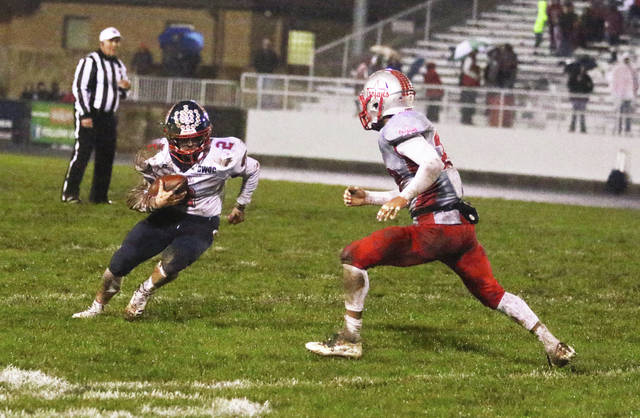 Tom Lillicrap/For The Call Piqua's Colin Roe looks for running room after making a catch Friday night against Troy.