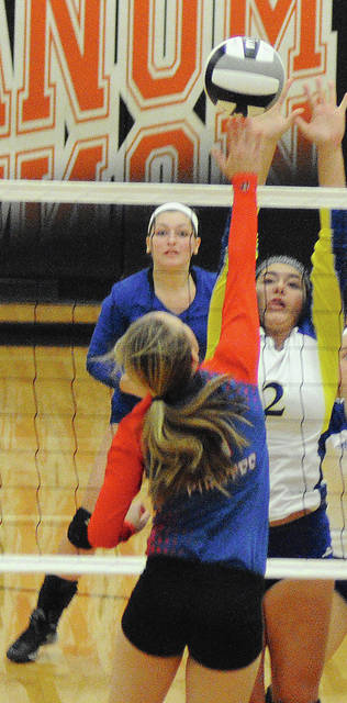 Rob Kiser/Call Photo Lehman Catholic's Ellie Scott goes up for a block as Hailey Wick backs up the play Wednesday against Riverside.