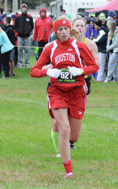 Rob Kiser/Call Photo Houston's Hollie Voisard holds off the runners behind her Saturday.