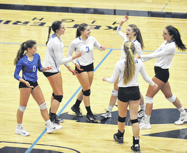 Josh Brown/Troy Daily News The Miami East volleyball team celebrates winning a point during Thursday's regional semifinal against Anna at Trent Arena.