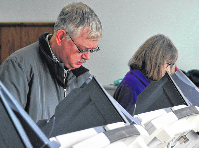 Piqua resident Mark Wion casts his ballot on Tuesday