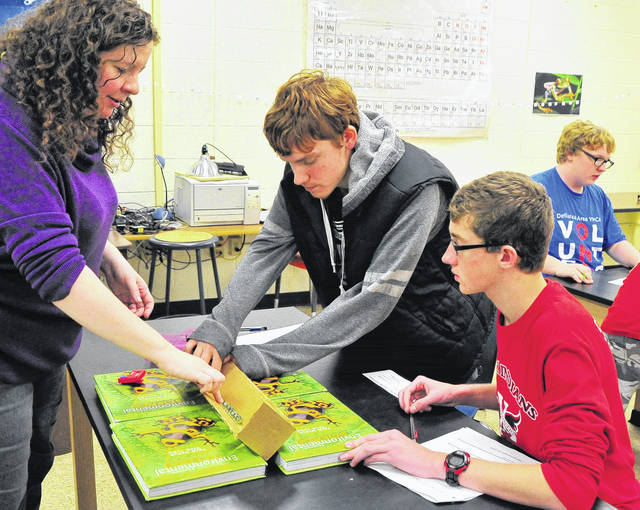 Mike Ullery | Daily Call Piqua High School astronomy teacher Amanda Ferncez, left, works with Austin Harshman. center, and Preston Schaefer as students study Newton's Laws. Astronomy has proven to be a popular subject in its first year of being offered at PHS.