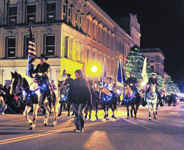 Mike Ullery | Daily Call An Honor Guard carrying the US Flag, followed by flags of the five branches of the Armed Forces, led off the 2017 Mainstreet Piqua Horse Parade through the downtown on Saturday. More than 30 equestrian units took part in the parade which saw a crowd, estimated at more than 2000, turn out in downtown Piqua.