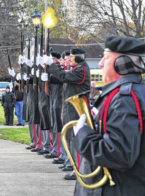 Mike Ullery | Daily Call The Veterans Elite Tribute Squad fires a 21-gun salute to honor all of America's veterans during the annual Piqua Veterans Day ceremony on Saturday.