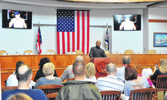 Mike Ullery | Daily Call Chris Draft, a retired NFL linebacker, speaks at the Piqua City Commission Chambers on Friday about lung cancer awareness. The event was held to support retired Piqua Firefighter Jeff Meckstroth who has been fighting the disease for the past two years. Jeff's wife, Rhonda, who serves as administrative assistant for the Piqua Fire Department contacted Draft about possibly coming to Piqua. Draft, who had lost his wife, Lakeasha, to lung cancer in 2011 and has since been heavily involved with spearheading the fight for more research and approval of drugs to fight lung cancer, was in Piqua 48 hours later and ready to help. (Additional photos from the event can be found on page 7)