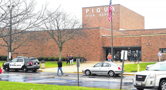 Mike Ullery | Daily Call Students leave Piqua Hgh School around noon on Thursday as parents wait to pick them up following rumors about possible threats that prompted school officials to issue a lockdown at the school and an early dismissal.