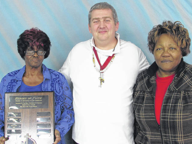 Sam Wildow | Daily Call From left to right: Patty Lucas of the Piqua Area Assocation of Churches (PAC) and Piqua's Cyrene AME Church; Paul Green, president of PAC; and Theodorsia Gray of PAC and Piqua's Cyrene AME Church posing with the Hero of Faith award that has the late Susan Reed's name engraved on it.
