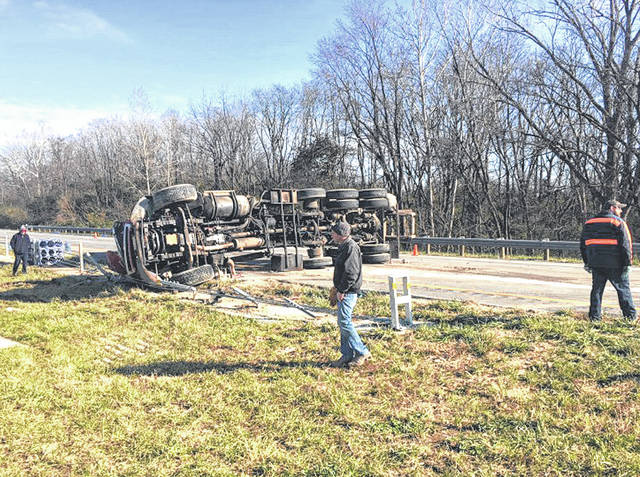 Dominic Wilson | WDTN photo A truck rolled on its side after striking the truck in front of it during a Friday crash on northbound I-75 near mile marker 78 that closed down two lanes and tied up traffic for hours.
