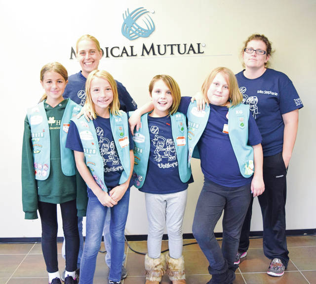 Provided photo Piqua Girl Scouts Isabella Freshour, Kiara Grilliot, Natalie Hemmert and Miranda Sweetman with their troop leaders Destinie Warren and Stephanie Freshour.