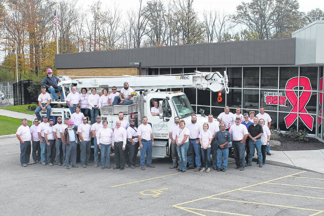 Provided photo Pioneer employees pose for a photo in front of the Piqua facility wearing pink T-shirts.