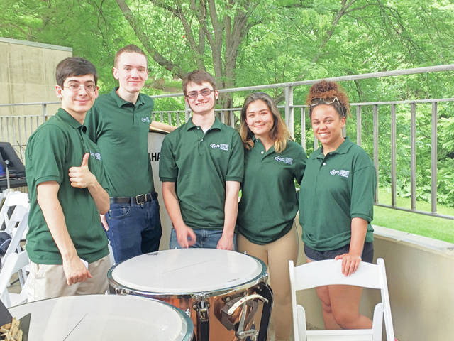 Provided photo Ethan Marsh of Piqua, center, hangs out with fellow members of the Cincinnati Symphony Youth Orchestra percussion section at a concert earlier this year. Pictured, left to right: Adrian Mester, James Leonard, Marsh, Zion Sosa, and Hannah Willingham (not pictured, Jacob Harmon). Marsh also plays with the Springfield Youth Symphony and takes private music lessons at Wright State University.