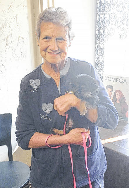 Provided photo Janice Hayes, of Covington, shows off her new furry companion, Roxy, gifted to her by numerous members of the Covington community after the death of her previous four-legged friend, Taz.