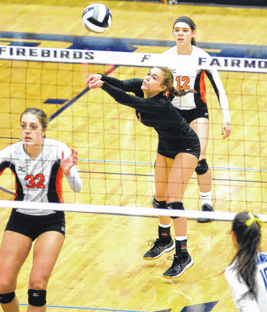Kyle Shaner/Aim Media Photo Kami McEldowney digs the ball for Versailles as Danielle Winner (32) and Cassie Peters (12) look on.