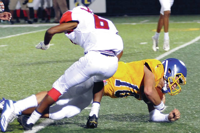 Aim Media Photo Lehman Catholic's Elliott Gilardi fights for yardage in the first meeting with Lima Perry.