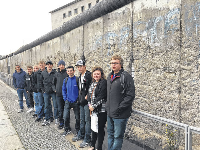 Provided photo Pictured are the Upper Valley Career Center students who participated in the German American Apprenticeship Partner program at the Berlin Wall, including, left to right, Blake Ike, Kaeden Reier, Justin Meyer, Nathan Hausfeld, Kyle Mills, Mitchell Hueing, Andrew Highman, Mason Schaffer, Rachel Karnehm, and Levi Lavy.