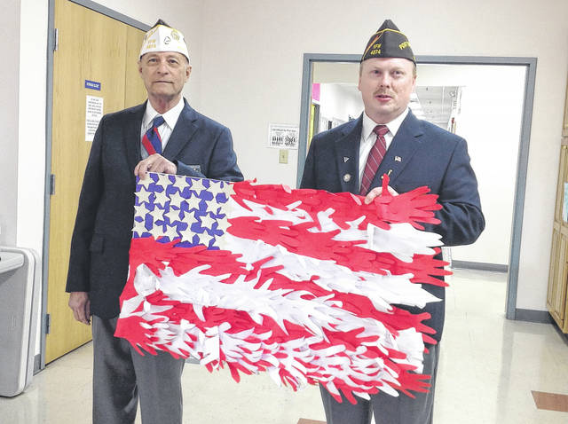 Provided photo Nicholas School held an assembly on Friday, Nov. 10, when they were visited by a few local veterans. The students presented some of the veterans with a handmade flag.