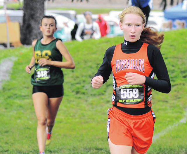 Rob Kiser/Call Photo Versailles' Maria Mangen runs at the regional meet Saturday.