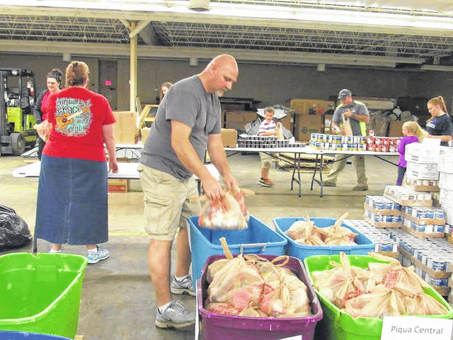 "Courtesy of Facebook Volunteers for the Piqua Munch Bunch program pack bags of food to distribute to local children in grades K-5 living in food-insecure households. ""Some kids have absolutely nothing to eat when they're not in school, and others have very little,"" program coordinator Kathy Bramlett said."