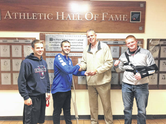 Provided photo Piqua High School Athletic Director Chip Hare, second from right, bought the first ticket in a fundraiser raffle for the baseball team's upcoming trip to Tampa, Florida. Pictured with Hare, left to right, are student athletes Cory Cotrrell, Austin Davis, and Derrick Hite.