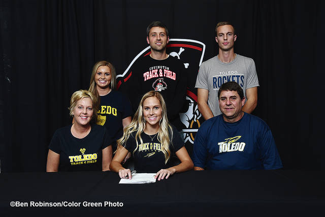 Ben Robinson/GoBuccs.com Rayna Horner signs her letter of intent to run for Toledo University. In front with Horner are her parents Dave and Kami Horner. In back are her sister-in-law Lexi Horner, Covington boys track and field coach Kyle Brumbaugh and brother Jaden Horner.